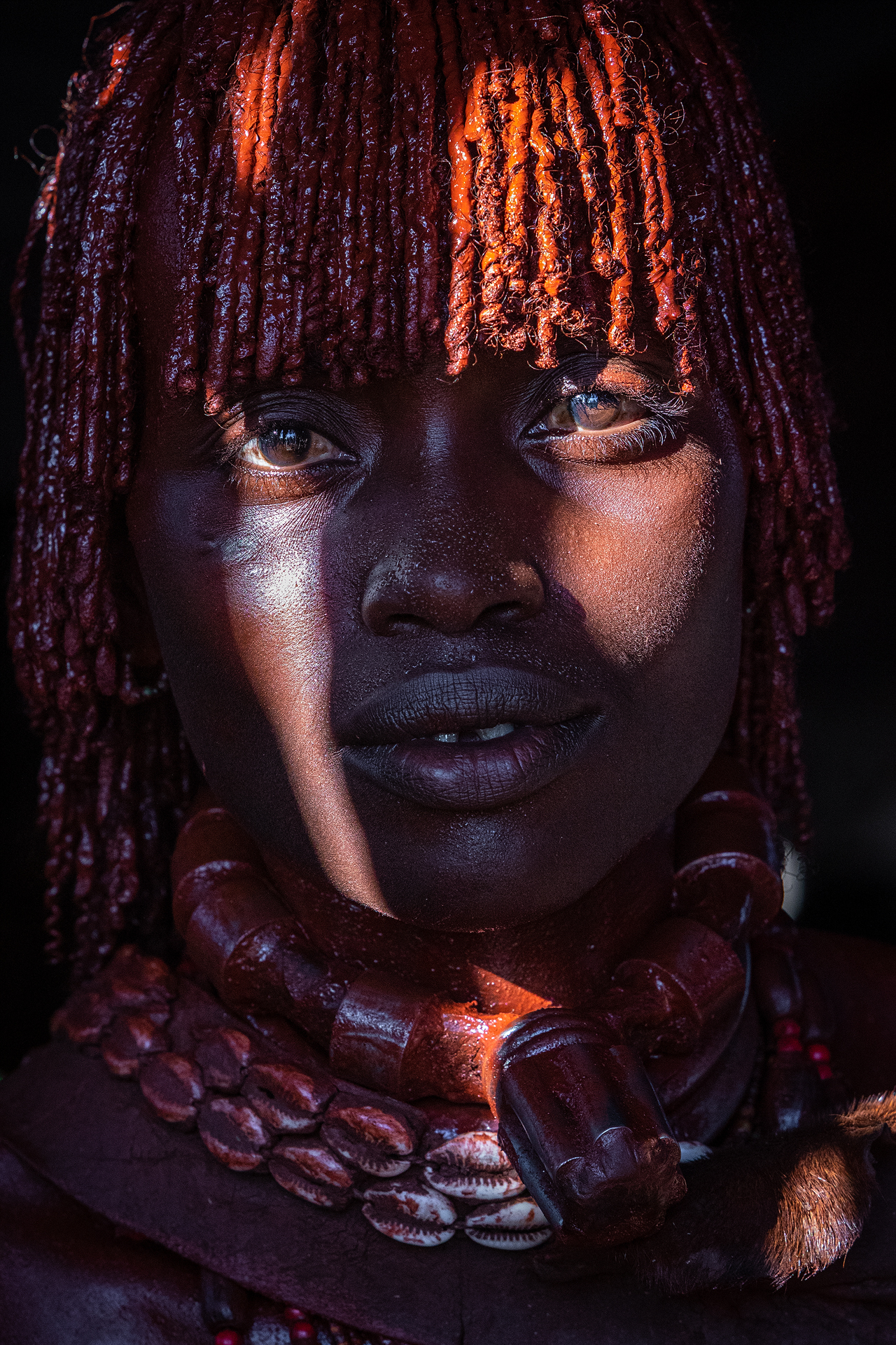 First wife, hamar woman, red body paint, african