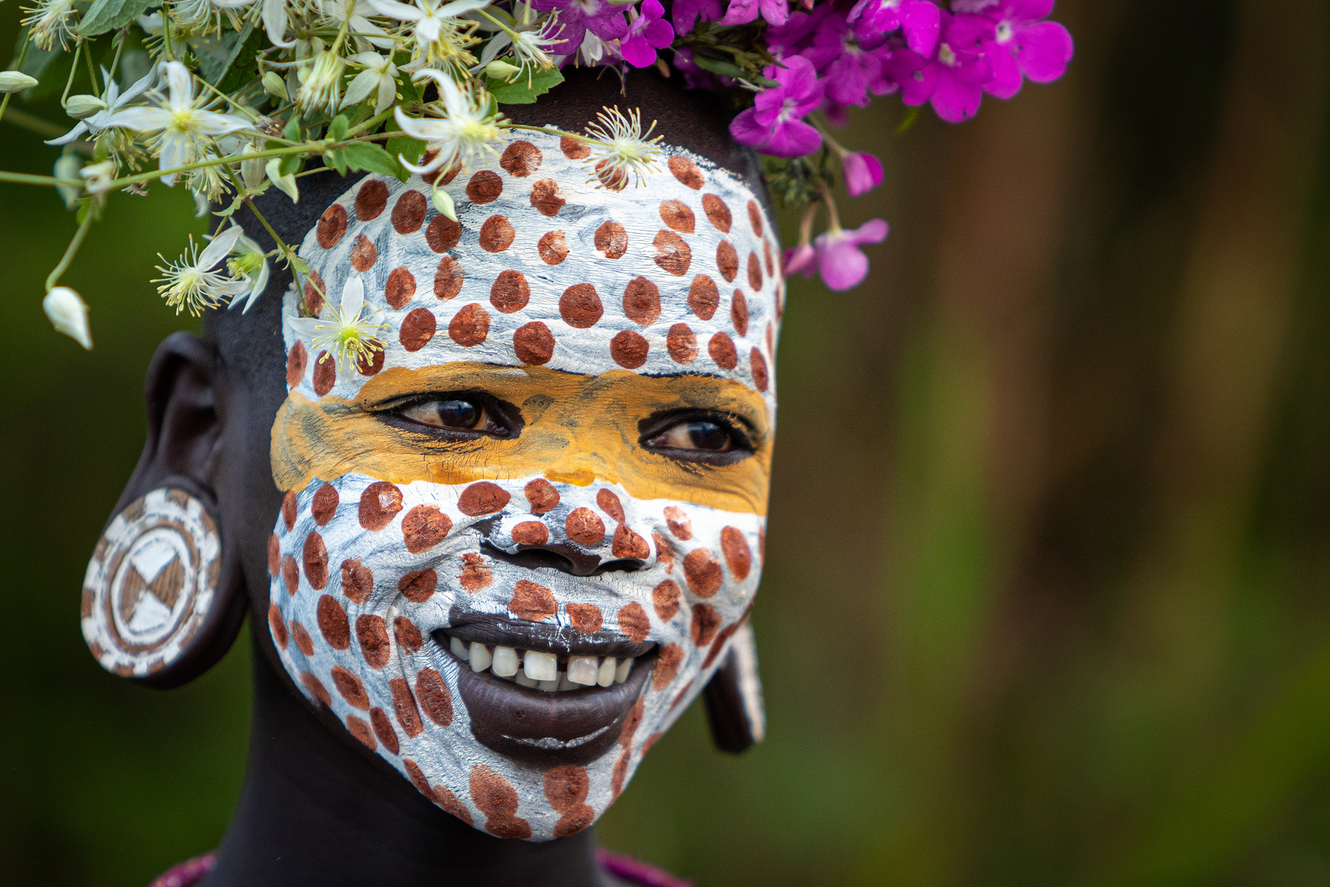 Girl with face paint smiling