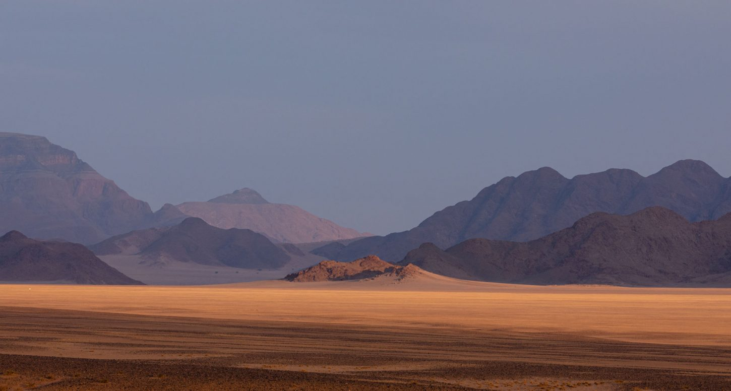 Landscape of mountains and sand dunes