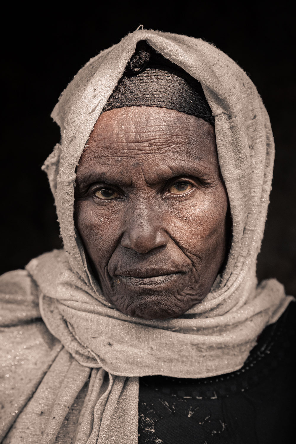 An ethiopian woman with a head scarf