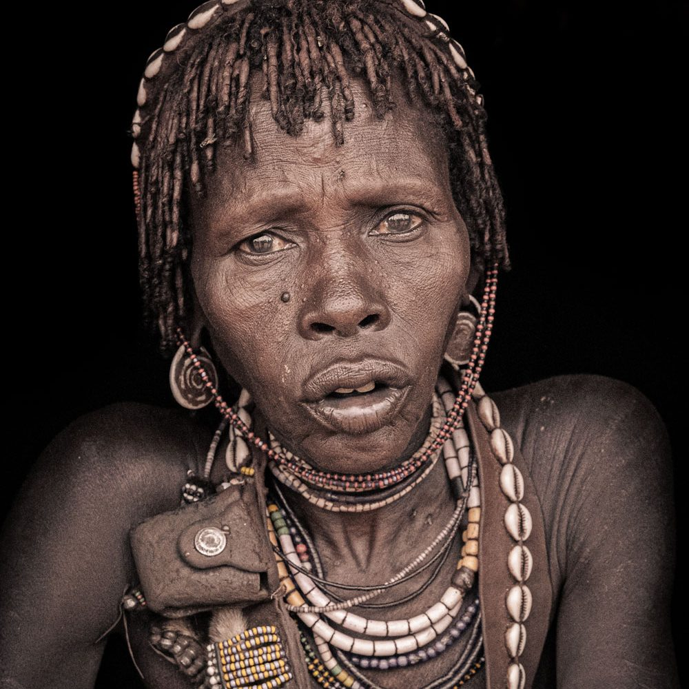 A traditional ethiopian woman with feather and beads